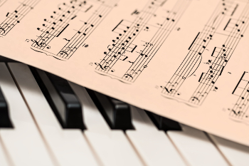 picture of piano keyboard with music