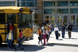 photo of student musicians getting off bus